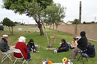 Grave of Ladon Sheats - Friend, mentor, anti-war and anti-nuclear activist. Rather than a head stone, Ladon requested that instead, an olive tree be planted. Gathered for a memorial. Ladon passed on August 7, 2002 - Ladon Sheats- PRESENTE!.4409