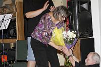 Jeff hands Martha flowers for her 25 years at the LACW.5927